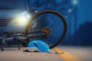 bicycle and car in collision on road