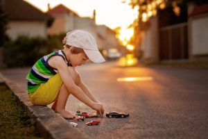 child plays in street